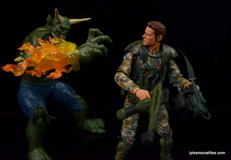 NECA Aliens Sgt Craig Windrix figure -facing an alien