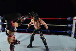 WWE Elite 41 Finn Balor -Pele kick to Seth Rollins