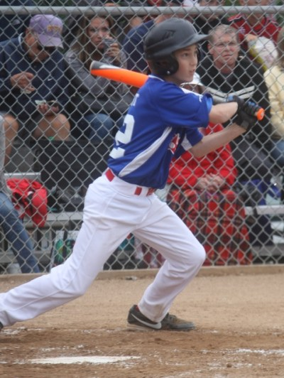 Pacific Little League's Ben Grant smacks a hit against Federal Way.