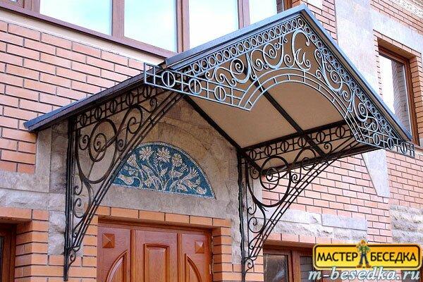 kovanniy-kozirek-nad-vhodom-012