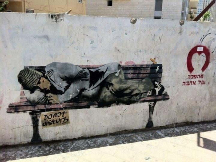 Homeless man on a bench street art