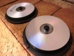 Recycle old CD's by cutting them up and using it to mosaic surfaces.