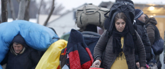 Refugees arrive in snowy weather at the transit center near the village of Tabanovce, in northern Macedonia, before continuing their trip further north to the border with Serbia, Sunday, Jan. 3, 2016. EU nations demonstrated starkly different views on how to deal with the 1 million migrants that crossed the Mediterranean in 2015. (AP Photo/Boris Grdanoski)