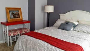 A Touch of Gray and Red Guest Room
