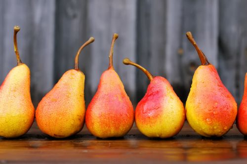 Ripe pears on a wooden table