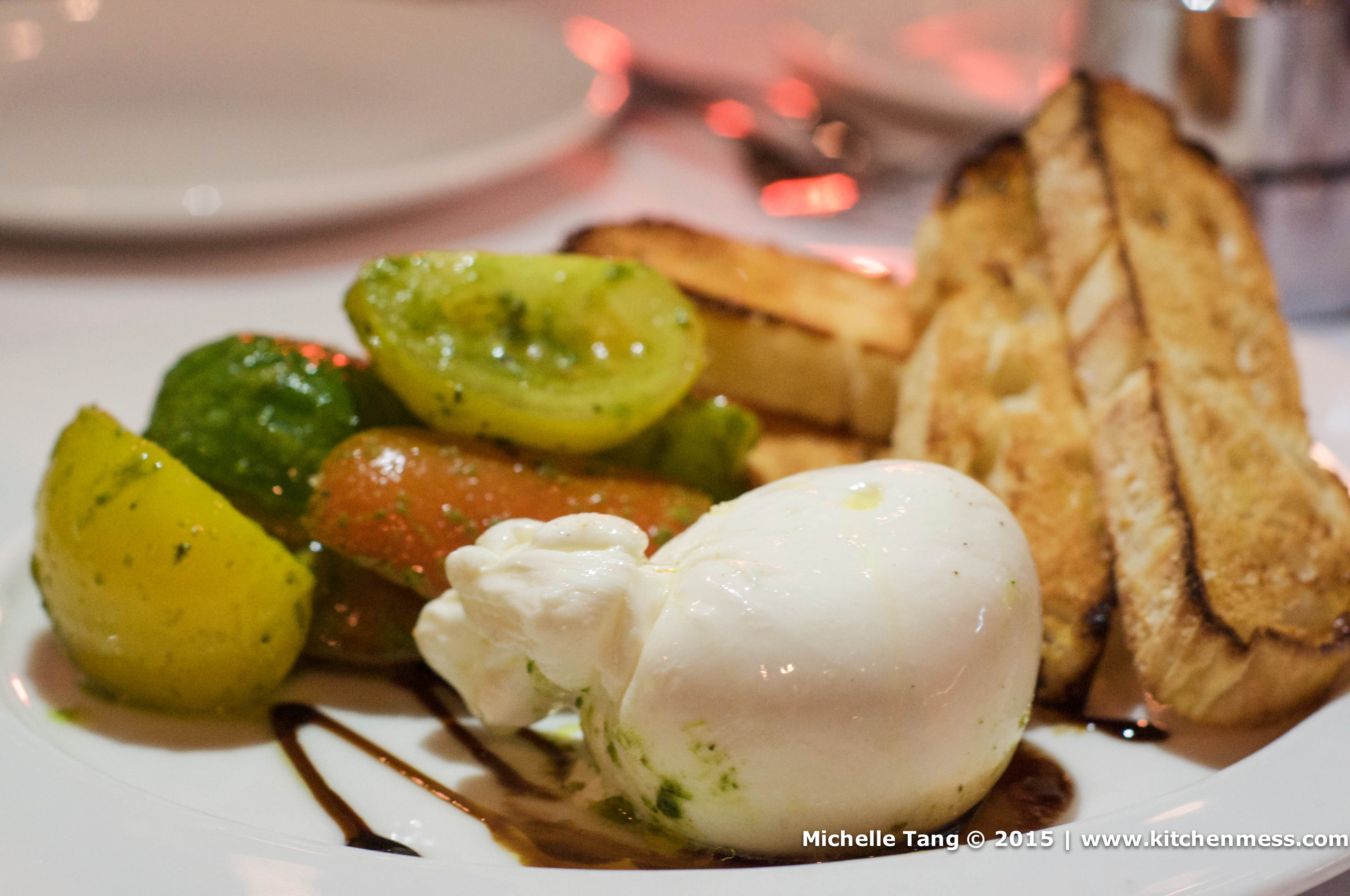 Burrata and Heirloom Tomato Salad marinated in balsamic pesto, with ...