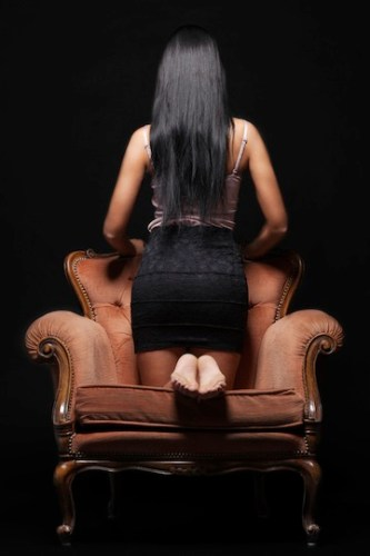 girl kneeling chair shutterstock_148683266 copy