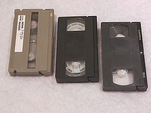 Three different VHS-family video cassettes. Fr...
