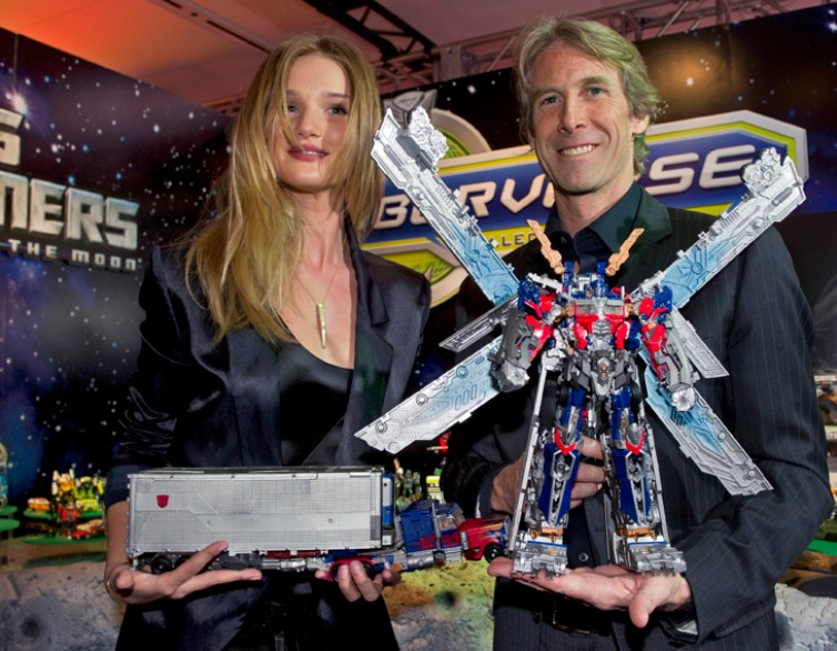 """""""Transformers: Dark of the Moon,"""" star Rosie Huntington-Whiteley and Michael Bay, director, look at new """"Transformers Ultimate Optimus Prime"""" at Toy Fair in New York"""