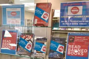 Library Banned Books Week display: Persepolis, Maus, The Great Gatsby, The Graveyard Book