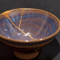 Broken ceramic bowl repaired with Kintsugi technique.