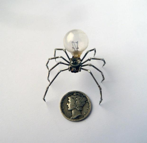 "About the size of a common house spider, the ""Spider"" series all have small lightbulbs in place of their abdomen."