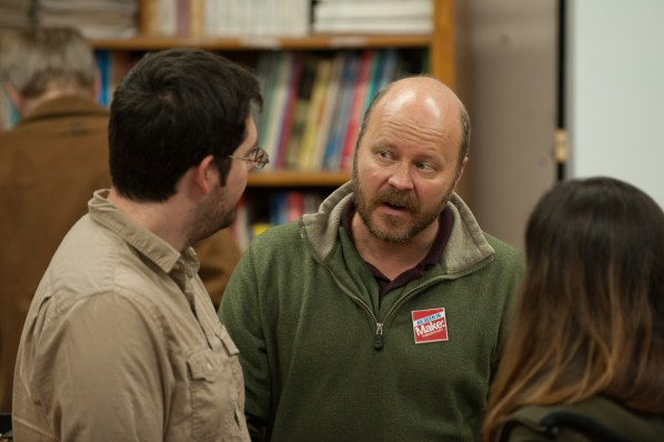 Project MAKE instructor Casey Shea talking with visitors of the open house.