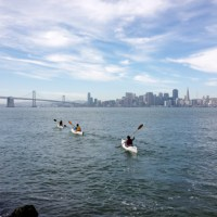 A flotilla of Oru heading out toward San Francisco and the Bay Bridge.