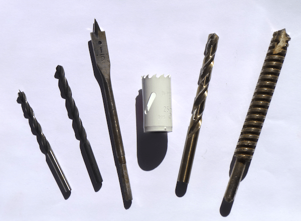 A properly used and maintained bit can last a long time, so know which bits are appropriate for which job. From left to right: small wood bit, high speed steel bit, spade bit, hole saw, cobalt bit, masonry bit.