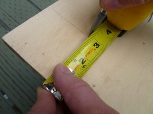 The most accurate way to make a straight line on a plywood sheet is to measure the width at both ends, then snap a chalk line. But if you're in a hurry, or the line doesn't need to be super accurate, you can scribe it by setting your width with a tape measure, planting a pencil on your mark, and sliding it down the length of the board. Make sure to keep the tape perpendicular to the board edge.