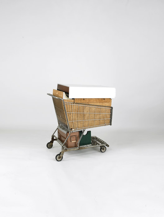 The cart folded down into the shopping trolley