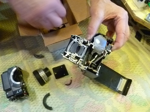 Cliff wanted to cut an SLR camera in half just for fun, so he set up a motorized track on a diamond band saw and used an Arduino to set the cutting rate.