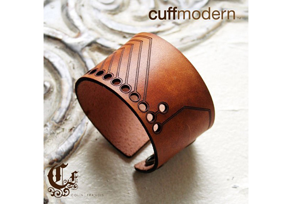 This laser-cut and etched circuit board-inspired cuff from CollinFrancisDesign is interesting.