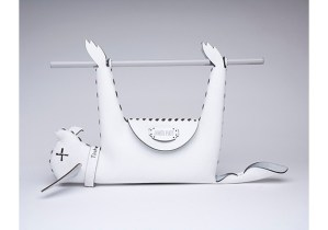 "Designer James Piatt is known for his provocative laser-cut handbags — the one above is ""based on Paris Hilton's discarded pet Tinkerbell."""