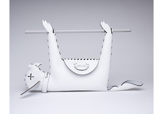 """Designer James Piatt is known for his provocative laser-cut handbags — the one above is """"based on Paris Hilton's discarded pet Tinkerbell."""""""