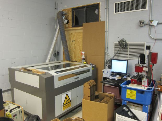 Dave & Co. blasted through the wall and opened up a storage area to bring in their new Full Spectrum laser cutter.