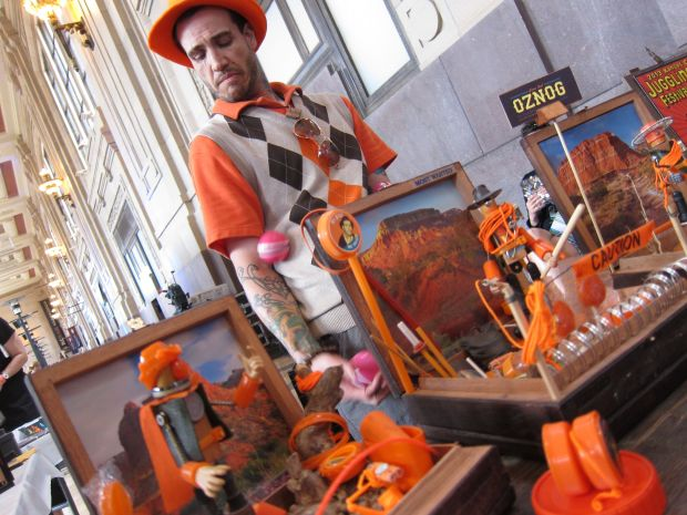 Just used to compulsively buy toys but now he makes toy worlds instead.  And juggles.  And wears orange.