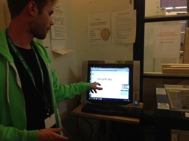 Trent Rohner explaining the Laser Cutter