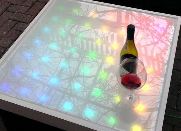 Animated Arduino LED matrix lounge table top.