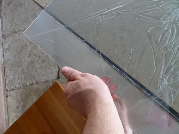Set the plexi on the edge of a flat surface and push down to break it along the line.