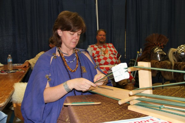 Erin Bryant works intently on her antique loom.