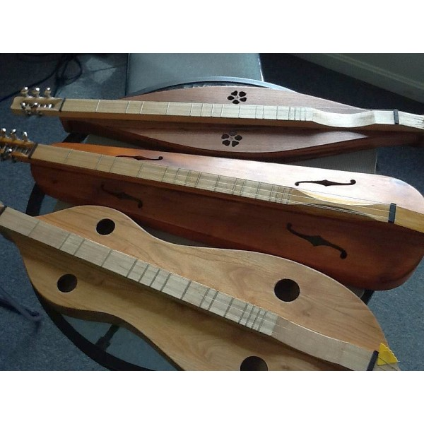 Dulcimers made from recycled violin cases by Hewn from the Mountain. www.hewnfromthemountain.com