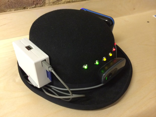 The bowler hat, with the Raspberry Pi (left), camera and LEDs (center) and battery pack (far side).