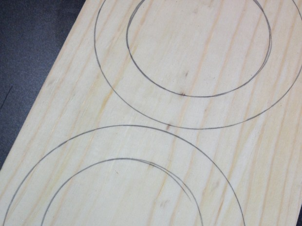 Start with a series of rings drawn onto pine boards. I used a roll of tape as the template.