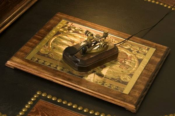 "Mouse (built into an old Morse code ""clacker"") and foil-map mousepad"