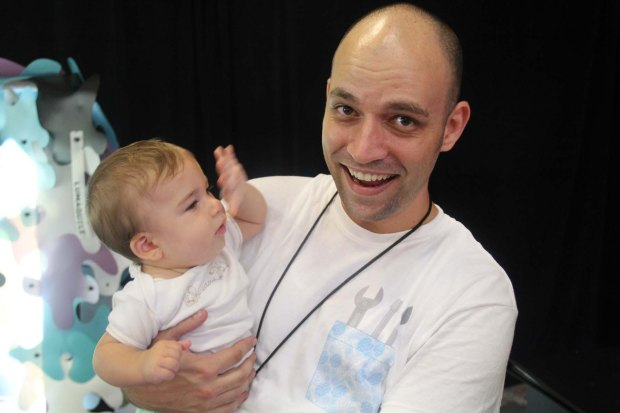 One of the Miami Mini Maker Faire Organizers, Mike Greenberg pauses for a quick minute with his daughter.