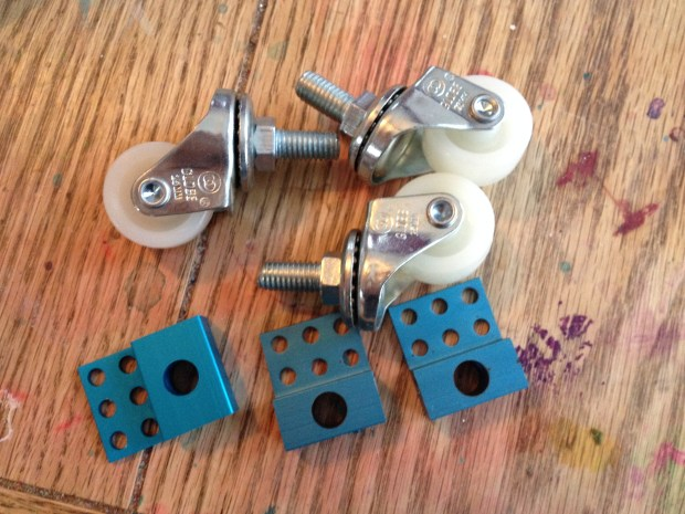 Caster wheels and their mounting plates.
