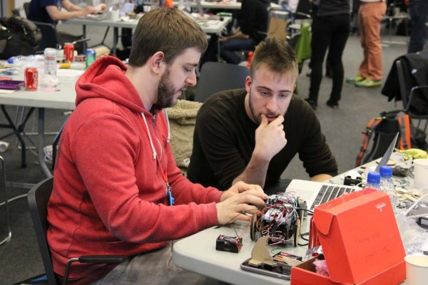 Jon (@jonmarkgo)  & Swift (@SwiftAlphaOne) working intently on their SumoBot.