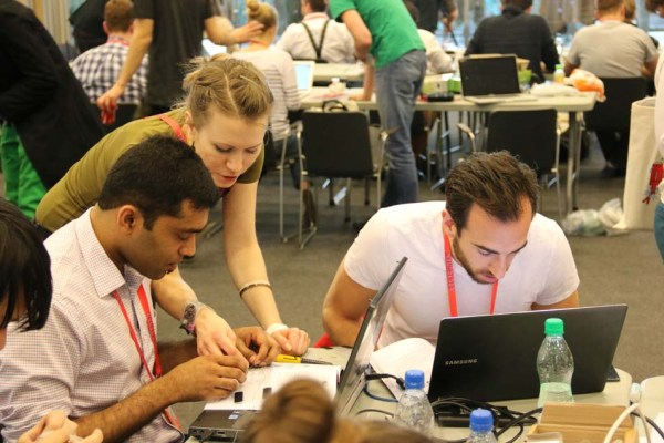 Karolina Chmiel and Antoni Kedracki taught attendees to build a smart watch using a LilyPad microcontroller.