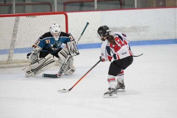 Angela playing goalie on the Jr. Sharks ice hockey team.
