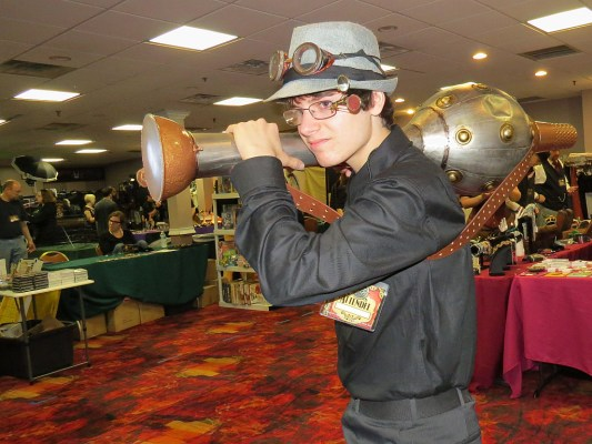 An old dented metal vase, some bowls and a lamp, some paint and other details, and this attendee had a cool steampunk weapon.