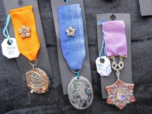 Custom designed medals by Shara Donohue of Mad Dash Studios.  http://maddashminstrels.etsy.com