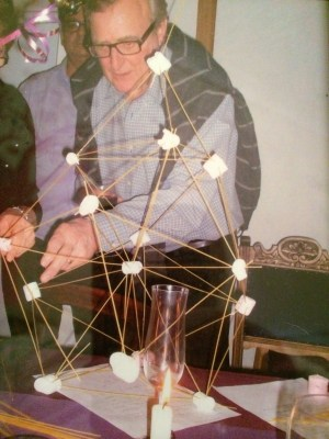 Here's my Dad, Derek with a triangulated structure he built at a party out of marshmallows and spaghetti. I think there was some kind of party competition about who could build the tallest structure out of these components alone. Dad realised out that triangles were the key. -- Dan Farnworth