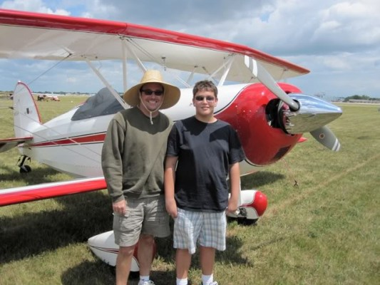 This is a photo of my dad and I from the 2009 Oshkosh EAA AirVenture fly-in in front of our old biplane. I was 14 in the photo, and we flew 2,500 miles from Southern California to Wisconsin over the course of 5 days, stopping every 200 miles along the way for fuel. It was an absolutely incredible trip, and we met a bunch of really cool people both on our way there and at the fly-in. --Bradley Matheus