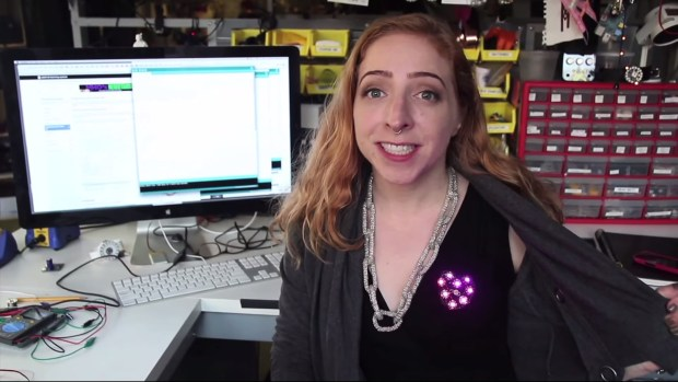 Turn on your heartlight. A GEMMA microcontroller with a light dependent resistor detects when this NeoPixel heart is uncovered and turns it on.  More info at: https://learn.adafruit.com/light-activated-pixel-heart