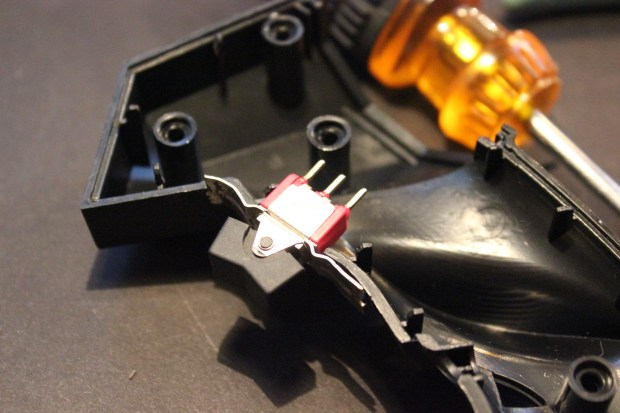 """Used nibblers to cut notches for rocker switches."""