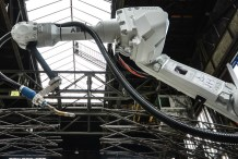 Robots Are 3D Printing a Bridge Right Underneath Them