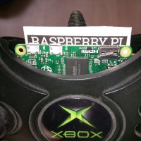 The Raspberry Pi Zero is small enough to fit inside of the original Xbox controller and is connected via a modified USB OTG cable.