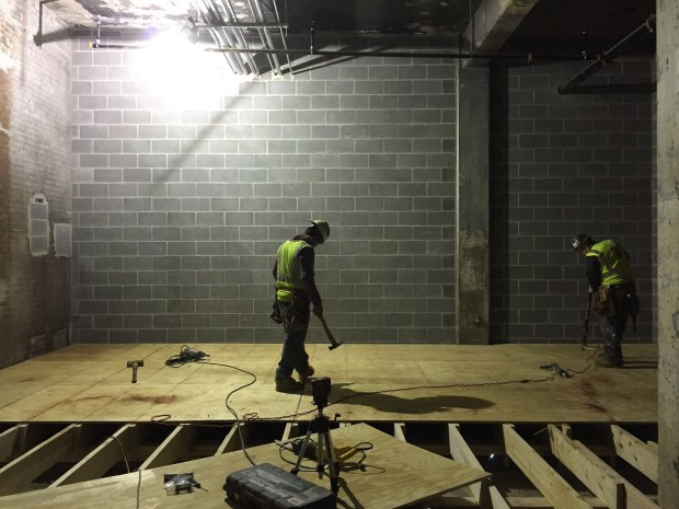 Finishing the floor in the member storage area.