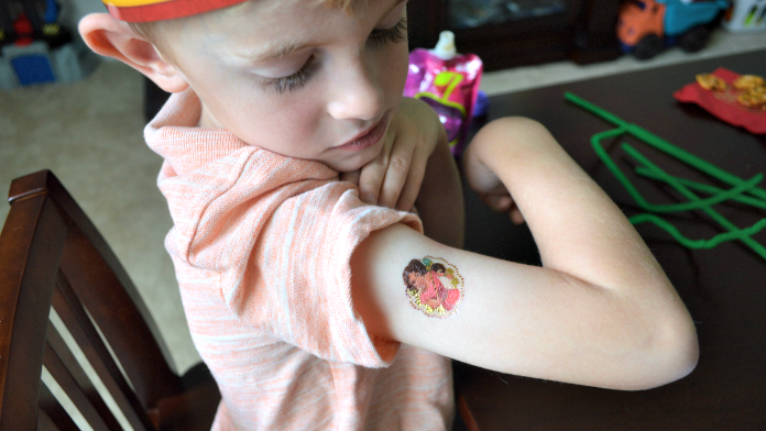 Aidan was excited about having a strong, confidant girl tattooed on his arm!